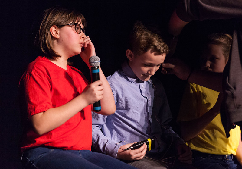 Tibby McDowell | The Sheridan Press<br /> <br /> Shaun Gonda, center, gets fitted for a mic to sing with Megan Bybee, left, and Charlize Gonda, right, during auditions for Stars of Tomorrow at Wyo Performing Arts and Education Center Tuesday Jan. 30, 2018.