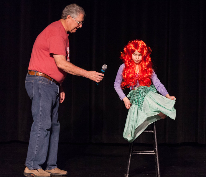 Tibby McDowell | The Sheridan Press<br /> <br /> Jim Wilhelm, left, hands Tess Bateman a microphone for her vocal performance during auditions for Stars of Tomorrow at Wyo Performing Arts and Education Center Tuesday Jan. 30, 2018.