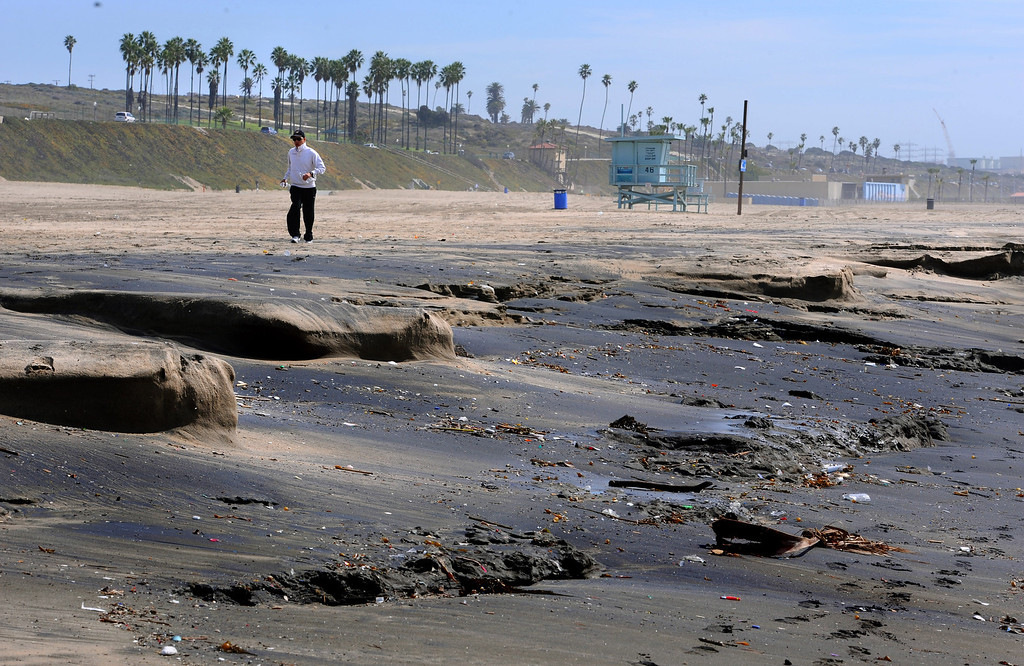 . Beach erosion in Playa Del Rey on Monday after weekend high surf washed away top layers of sand, leaving ugly, black oily sand and crud beneath. Photo by Brad Graverson/The Daily Breeze/3-3-14