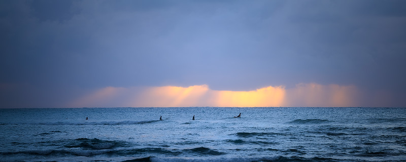 Surfers Waiting at Sunset