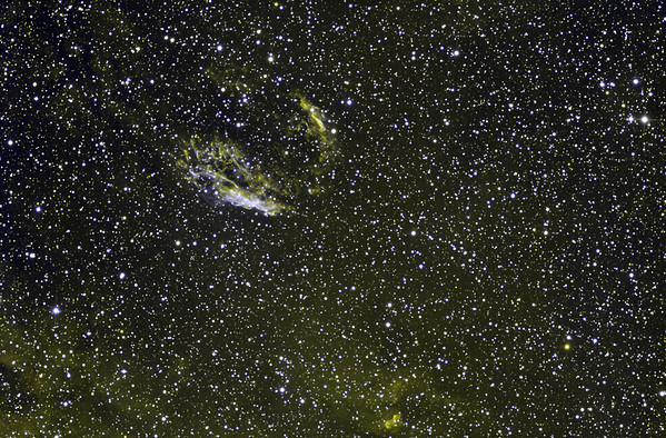 "The Norma Supernova Remnant, RCW 103, is much smaller and fainter than the Veil in Cygnus or the huge Vela SNR. It is very hard to photograph in RGB alone against the extremely busy Milky Way background. Yellow: H-alpha 9 hrs in 1 hr subs. Blue: OIII 2.5 hrs in half hour subs. Note the strong, twisting shock-fronts. General Milky Way H-alpha emission along bottom edge. North up. STL11000M on PlaneWave 20"" CDK on MI750 fork."