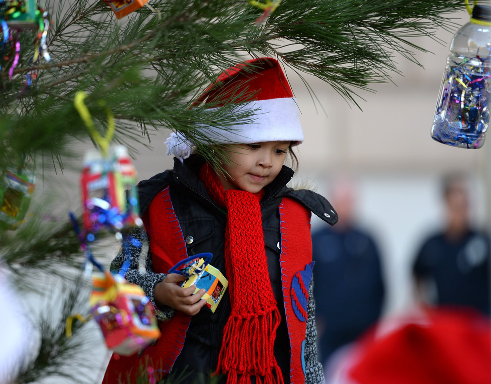 . A 25 year old time capsule was uncovered during the annual tree lighting at Pepper Tree Plaza Thursday, December 05, 2013, in San Pedro, CA.   Students from 15th Street School literacy program decorate the tree with enviro-friendly decorations. Photo by Steve McCrank/DailyBreeze