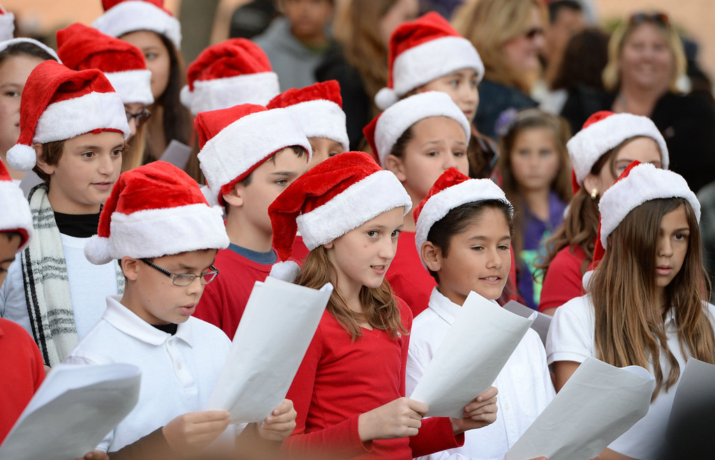 . A 25 year old time capsule was uncovered during the annual tree lighting at Pepper Tree Plaza Thursday, December 05, 2013, in San Pedro, CA.  Crestwood School students sing during festivities. Photo by Steve McCrank/DailyBreeze