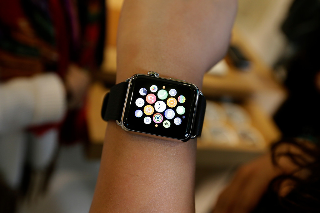 . A person poses with an Apple Watch for a picture in a store on Oxford Street in London, Friday, April 10, 2015. The technology company\'s latest product is on display in the store ahead of its full release for sale on April 24. (AP Photo/Tim Ireland)