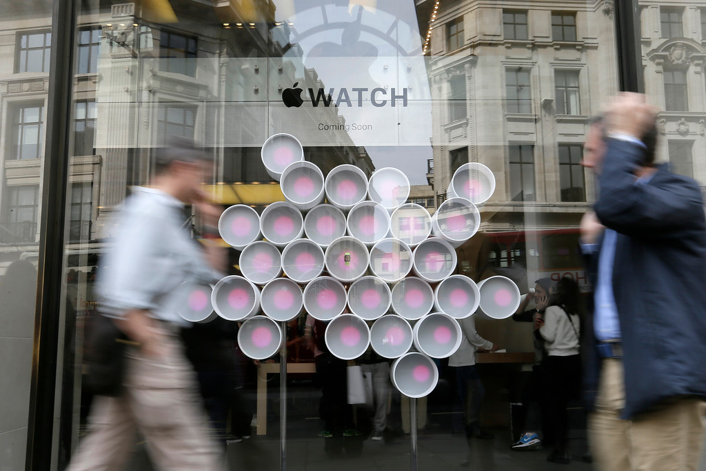 . An Apple Watch on display, centre, in the window of the Apple store on Regent Street in London, Friday, April 10, 2015. The technology company\'s latest product is on display in the store ahead of its full release for sale on April 24. (AP Photo/Tim Ireland)