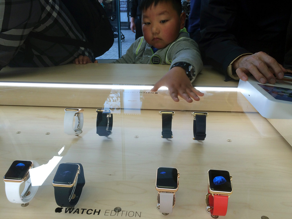 . A child looks at a display of Apple Watches at an Apple retail store in Beijing Friday, April 10, 2015. From Beijing to Paris to San Francisco, the Apple Watch made its debut Friday. Customers were invited to try them on in stores and order them online. China was among countries where the watch had its global debut Friday, reflecting the country\'s fast-growing status as one of Apple\'s most important markets. (AP Photo/Ng Han Guan)