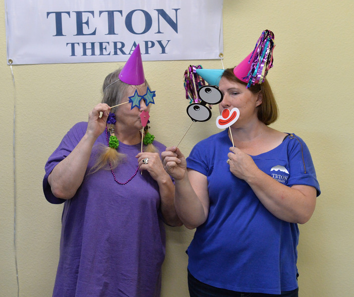 Ryan Patterson | The Sheridan Press<br /> Patient Nita Hikida, left, and Teton Therapy co-owner Ginny Rieger have some fun in the photo area at Teton Therapy's evening of entertainment Thursday, Sept. 6, 2018. The evening celebrated the company's two-year anniversary and had games and food centered around a carnival theme.