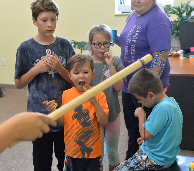 Ryan Patterson | The Sheridan Press<br /> From left: Braedyn McCalla, Skylar Bougie, Zoey Bougie and Emmett Klepperich watch a person play a game at Teton Therapy's evening of entertainment Thursday, Sept. 6, 2018. The evening celebrated the company's two-year anniversary and had games and food centered around a carnival theme.