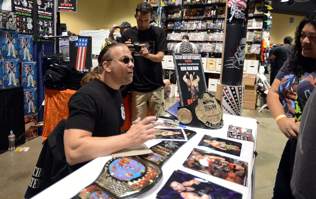 . Pro Wrestler and comic book fan RVD Rob Van Dam signs autographs at  the 5th annual Long Beach Comic Con & Horror Con, held at the Long Beach Convention Center.   Long Beach Calif., Saturday, November, 23, 2013.   (Photo by Stephen Carr / Daily Breeze)