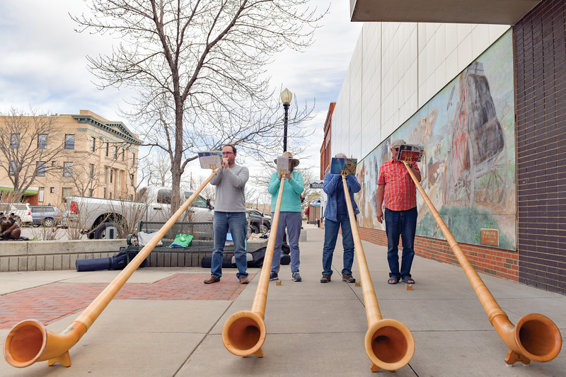 Matthew Gaston | The Sheridan Press<br>The Big Horn Alphorns play on a street corner in Sheridan Saturday, April 20, 2019. The alphorn is a labrophone, consisting of a straight several-meter-long wooden naturl horn of conical bore, with a wooden cup-shaped mouthpiece.