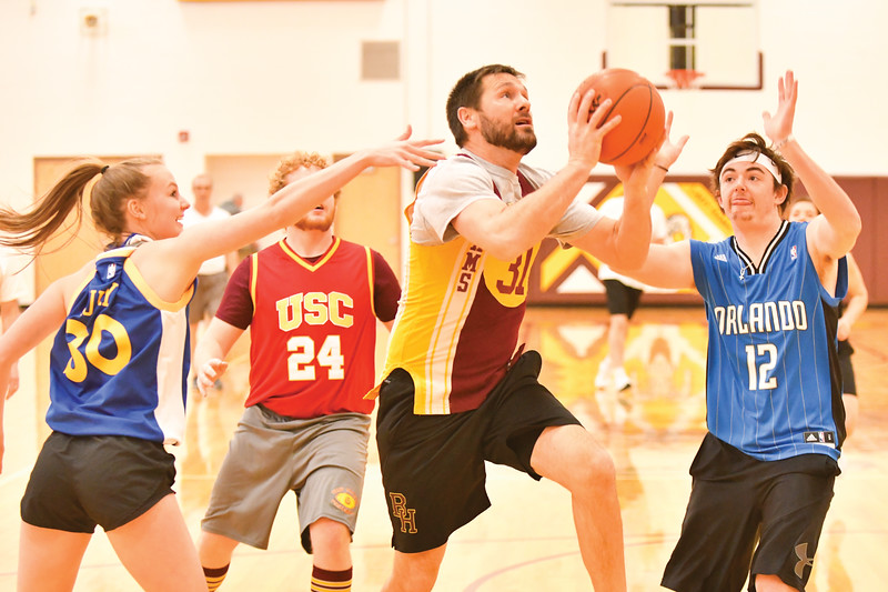 Matthew Gaston | The Sheridan Press<br>Big Horn faculty all-star Kirk McLaughlin fearlessly drives the lane two during the Seniors verse the Faculty game Thursday, Jan. 31, 2019. McLaughlin's play in transition was instramental to the Faculties 48-42 victory.