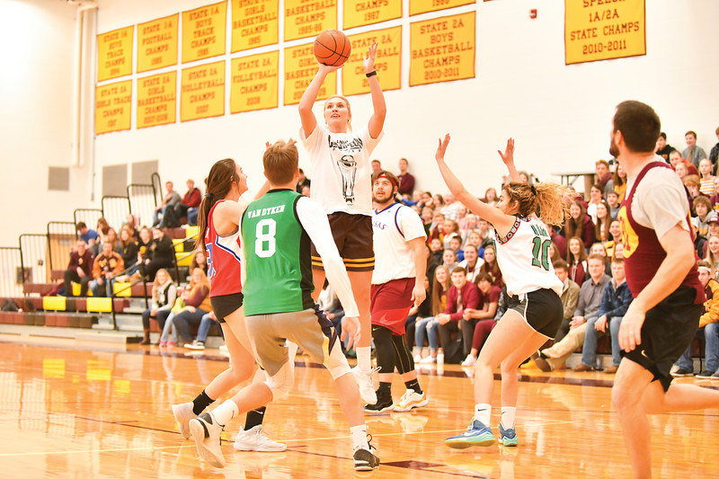 Matthew Gaston | The Sheridan Press<br>Even when being defended by four fifths of the oppositions starting line-up, the Faculties Kayla Woodward could not be stopped. Woodward's performance on the court was head-and-Shoulders above the rest Thursday, Jan. 31, 2018.