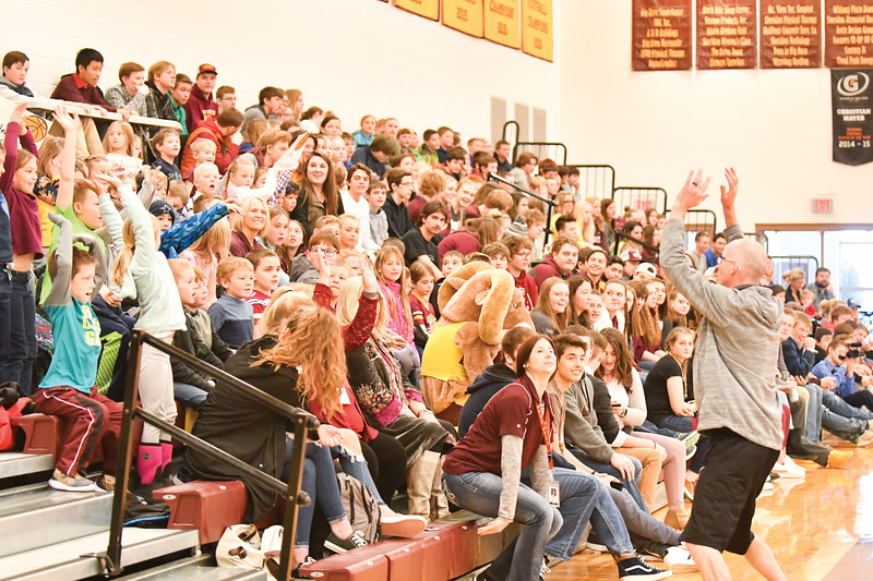 Matthew Gaston | The Sheridan Press<br> The Lady Rams head coach Kip Butler gets the crowd involved during the Seniors verses the Fauclty game by starting the wave Thursday, Jan. 31, 2019.