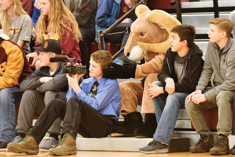 Matthew Gaston | The Sheridan Press<br>The Big Horn High School mascot tries in vain to distract J.B. Brogdon from his filming duties Thursday, Jan. 31, 2019.