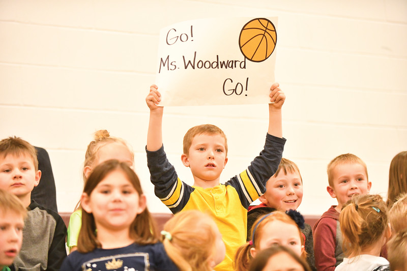 Matthew Gaston | The Sheridan Press<br>Big Horn Elementary School kindergartner, Waylon Brown, shows his unwavering support for the Faculty teams stand out player, Kayla Woodward Thursday, Jan. 31, 2019.