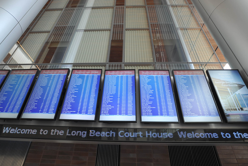 . A tour to compare the existing Long Beach Courthouse with the new Gov. George Deukmejian Courthouse in Long Beach showed how the new facility will help enhance operations at the courthouse, with airport-like screens displaying the cases for the day.  (Photo by Sean Hiller/ Press Telegram/ LANG) 08-27-2013
