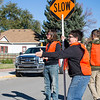Ashleigh Fox | The Sheridan Press<br>Gabrial Holcomb stops traffic and encourages runners during The Link — Partners in Pink run Saturday, Oct. 20, 2018. Boy Scout Troop 117 volunteered as traffic control near Whitney Commons Park.