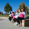 Ashleigh Fox | The Sheridan Press<br>Sheridan High School cheerleaders wait to pump up the crowd at the 10th anniversary of The Link — Partners in Pink run Saturday, Oct. 20, 2018.