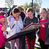 Ashleigh Fox | The Sheridan Press<br>Racers from left, Jenna Hansen, Heather Ostwald, Coral George and Aspen Hansen review The Link — Partners in Pink run map Saturday, Oct. 20, 2018.