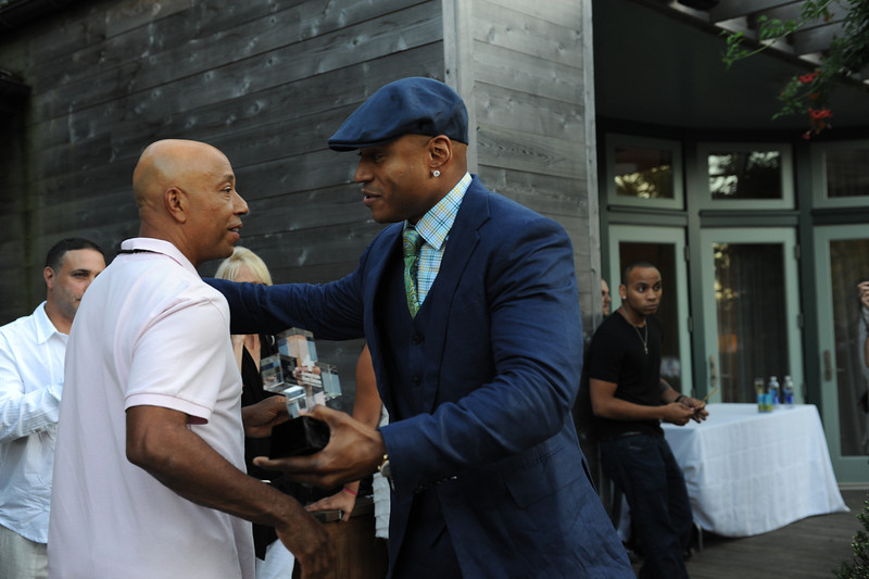 Sagaponack, NY - AUGUST 07:  Russell Simmons, And LL Cool J Attends  The Red Hot Red Cross Cocktail Fundraiser, where Entertainer LL Cool J is the recipient of the American Red Cross Humanitarian  on August 7, 2010 in Sagaponack, New York. (Photo by Joseph Bellantoni/In House Image)