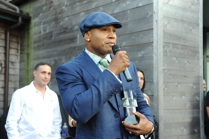 Sagaponack, NY - AUGUST 07:  LL Cool J Attends Attends  The Red Hot Red Cross Cocktail Fundraiser, where Entertainer LL Cool J is the recipient of the American Red Cross Humanitarian  on August 7, 2010 in Sagaponack, New York. (Photo by Joseph Bellantoni/In House Image)