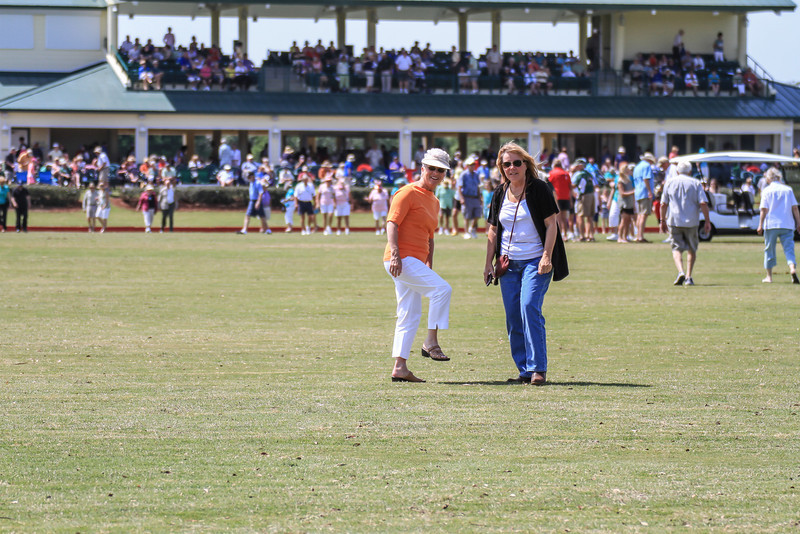 Lynda and Annette at half-time doing the traditional divit stomp....  This is where people come out on the field and flatten out the turf that has been torn up by the horses.