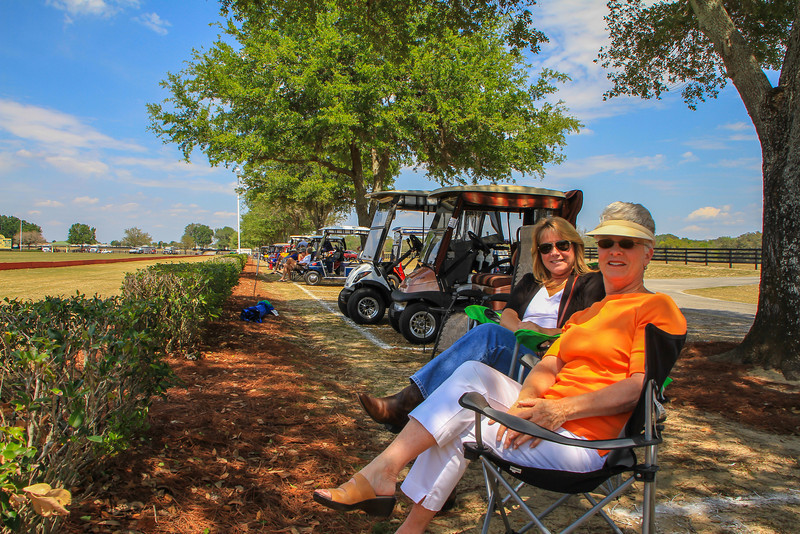 Lynda, my wife in the orange and white, with her girlfriend Annette, getting ready for a Sunday afternoon of polo.