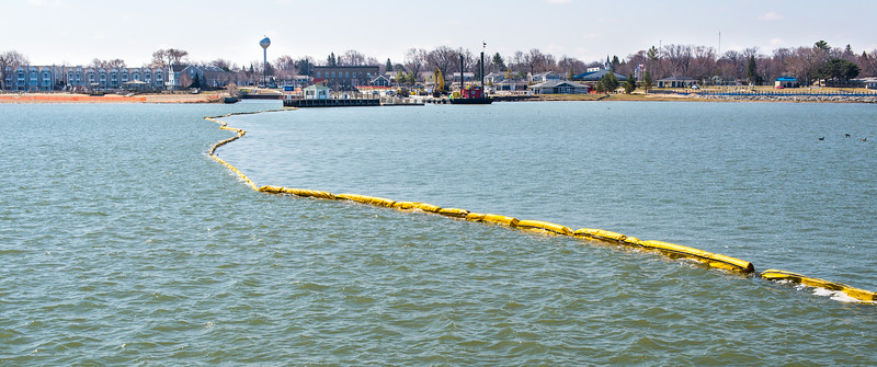 Oil boom protecting Port Austin Harbor during dock renovation project - April 2014