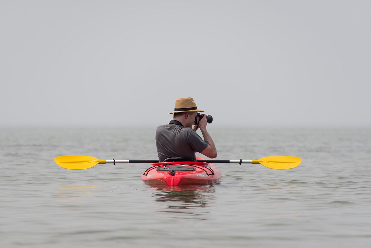 Eric taking aim while kayaking, July 2015