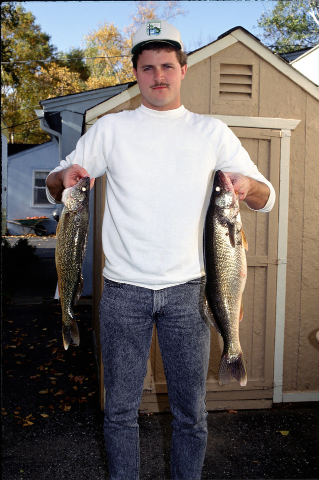 Eric with a couple nice Walleyes - October 1993