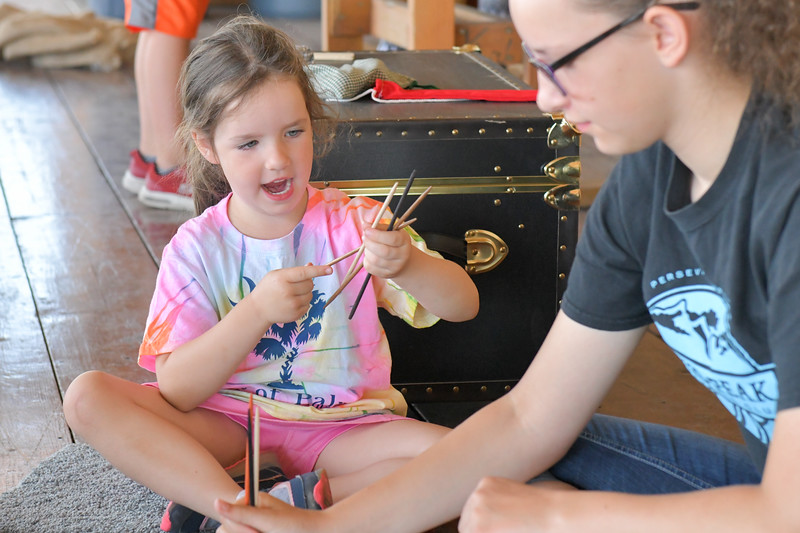 Ryan Patterson | The Sheridan Press<br /> Petra Gnehm, age 4, left, and Helyn Gnehm, age 12, play a game during Tidbit Tuesday at the Sheridan County Historical Society & Museum Tuesday, July 2, 2019.