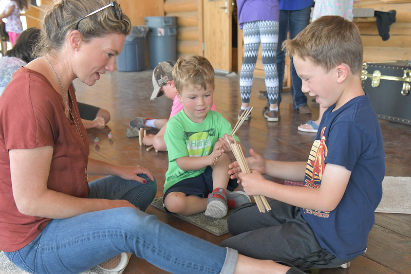 Ryan Patterson | The Sheridan Press<br /> From left: Kristin Smith, Owen Smith, age 4, and Ryan Smith, age 7, play a game during Tidbit Tuesday at the Sheridan County Historical Society & Museum Tuesday, July 2, 2019.