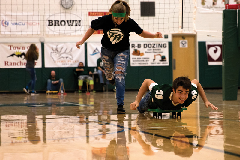 Matthew Gaston | The Sheridan Press<br>After pushing her partner to half court, sophmore ShayLynn Meiller narrowly avoids stepping on Tony Perfetti during the pep rally Thursday, Oct. 4, 2018.