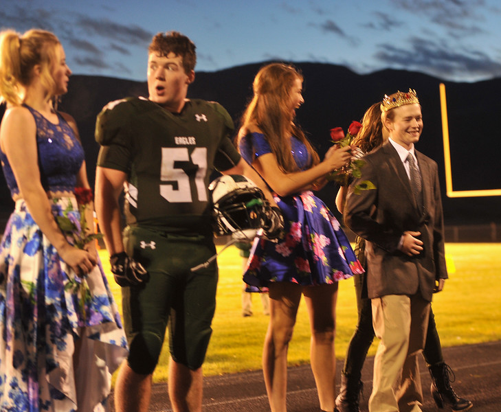Ryan Patterson | The Sheridan Press<br /> From left: Tongue River High School Homecoming Court members Dalaynie Dearcorn, AJ Lytton and Holly Hutchinson celebrate Theron Kalsinksy being named Homecoming King during TRHS Homecoming Week Friday, Oct. 5, 2018.