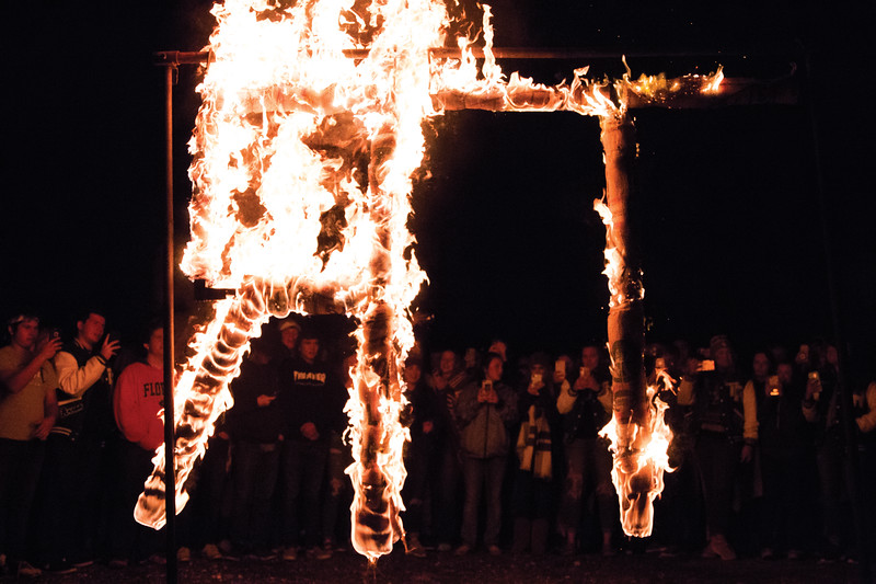 Matthew Gaston | The Sheridan Press<br>Tongue River High School students, phones in hand, take pictures and videos of the burning of the T. R. Thursday, Oct. 4, 2018.