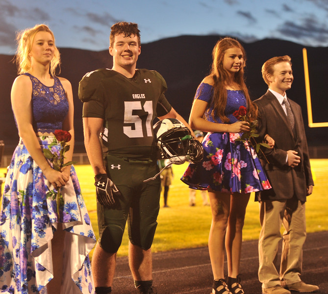 Ryan Patterson | The Sheridan Press<br /> From left: Tongue River High School Homecoming Court members Dalaynie Dearcorn, AJ Lytton, Holly Hutchinson and Theron Kalsinsky smile during TRHS Homecoming Week Friday, Oct. 5, 2018.