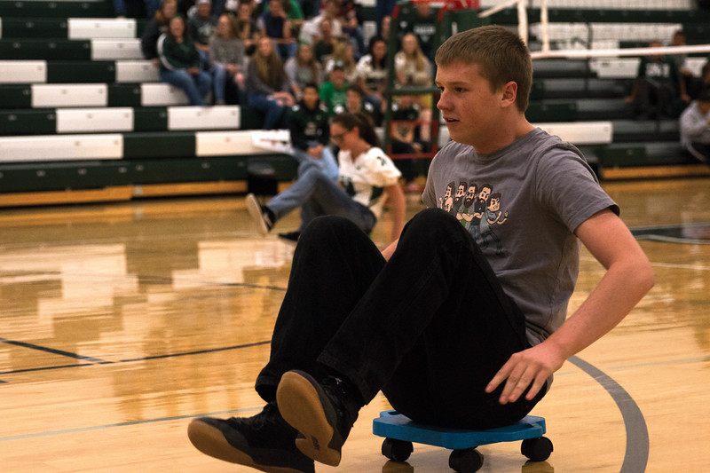 Matthew Gaston | The Sheridan Press<br>Tongue River senior Aaron Jensen, takes the lead in the relay race during the Homecoming pep rally Thursday, Oct. 4, 2018.