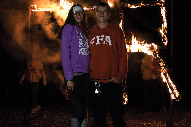 Matthew Gaston | The Sheridan Press<br>Macy McAthur poses with her boyfriend Aaron Jensen in front of the flaming T. R. Thursday, Oct. 4, 2018.