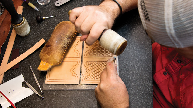 Matthew Gaston | The Sheridan Press<br>Ryan King has been a leathercrafter for 15 years. Here King adds a border detail to make his pattern stand out Friday, Oct. 12, 2018.