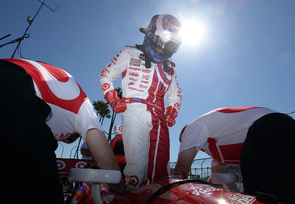 . Indycar driver Scott Dixon climbs into his race car as he he prepares to take to the streets of Long Beach Friday morning April 11, 2014 for the first practice session at the 40th Toyota Grand Prix of Long Beach.  (Will Lester/Inland Valley Daily Bulletin)