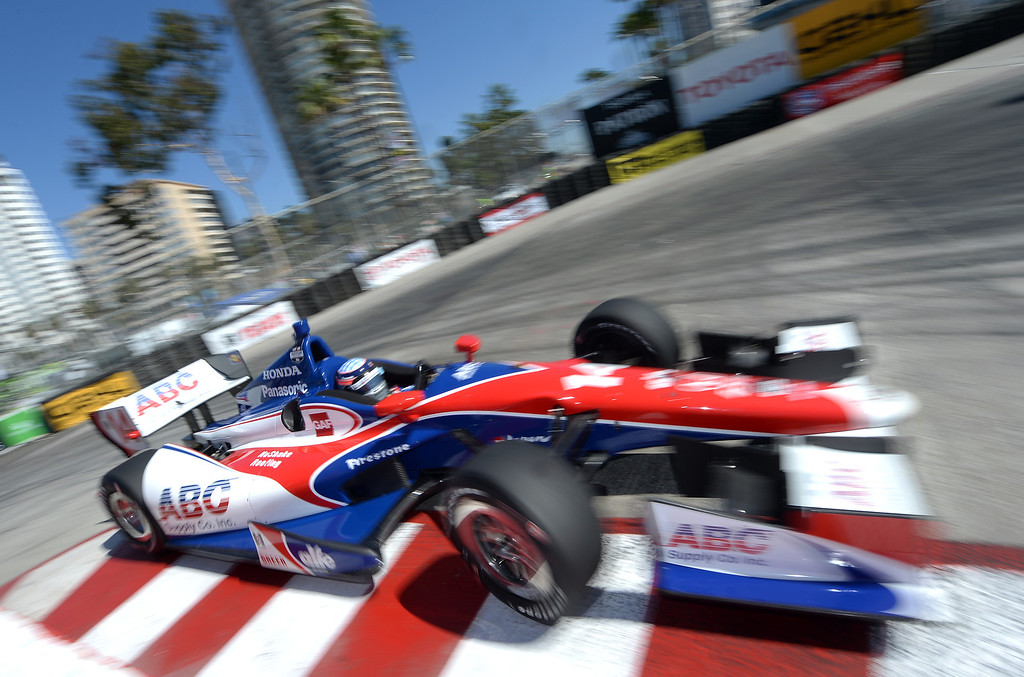 . Indycar driver and defending race winner Takuma Sato drives through the hairpin Friday morning April 11, 2014 in the first practice session at the 40th Toyota Grand Prix of Long Beach.  (Will Lester/Inland Valley Daily Bulletin)