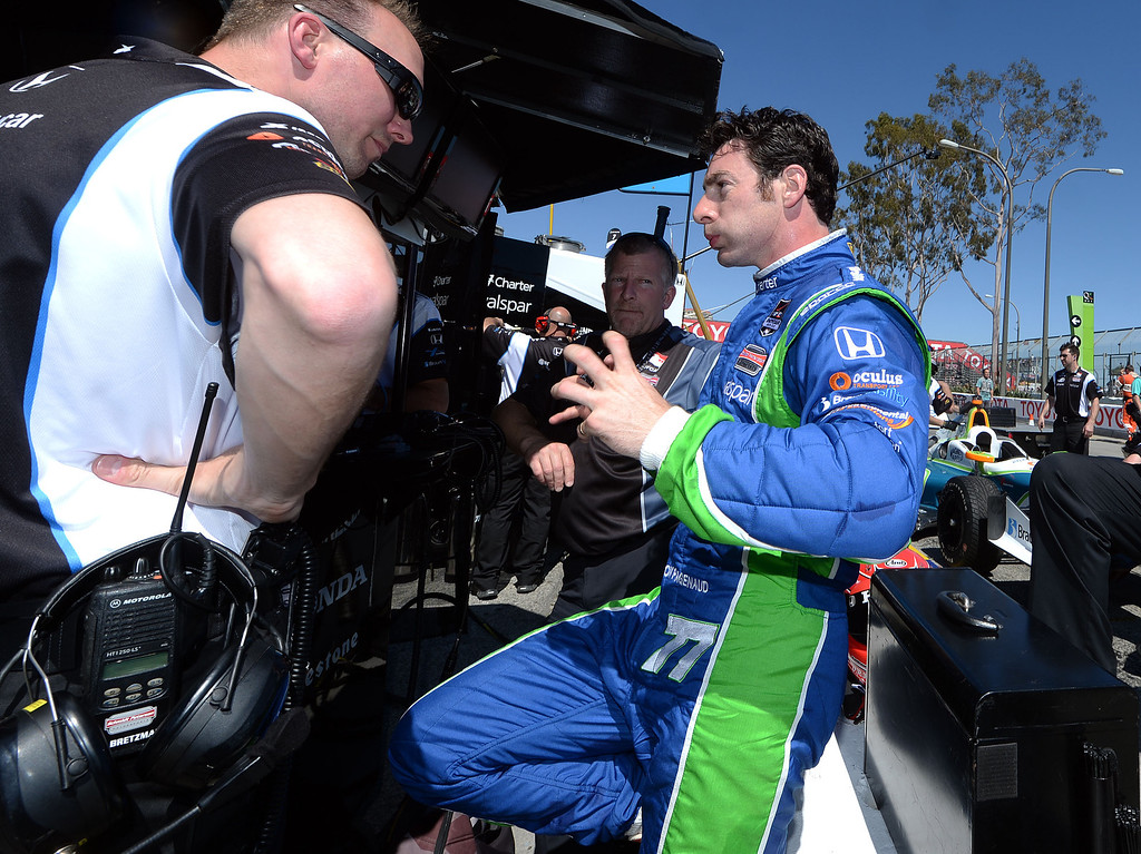 . Indycar driver Simon Pagenaud speaks to a crew member in the pit lane after posting the quickest practice time Friday afternoon April 11, 2014 during the second practice session at the 40th Toyota Grand Prix of Long Beach. Simon Pagenaud, from France, led drivers with the quickest lap time of the day. Qualifying for Sunday\'s race is Saturday.  (Will Lester/Inland Valley Daily Bulletin)