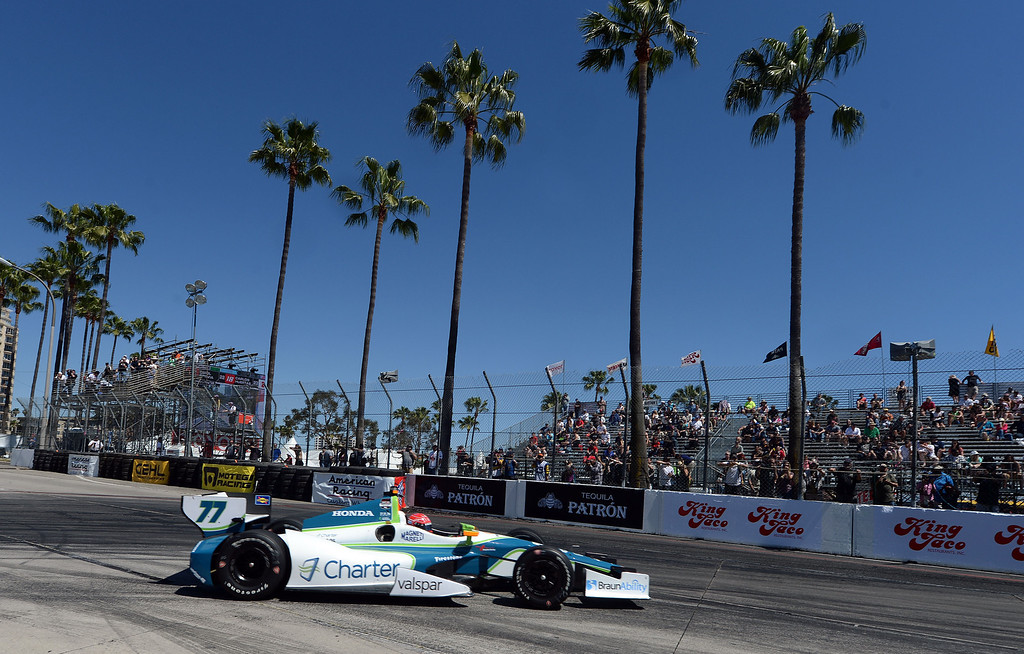 . Indycar driver Simon Pagenaud exits the hairpin  Friday afternoon April 11, 2014 during the second practice session at the 40th Toyota Grand Prix of Long Beach. Simon Pagenaud, from France, led drivers with the quickest lap time of the day. Qualifying for Sunday\'s race is Saturday.  (Will Lester/Inland Valley Daily Bulletin)