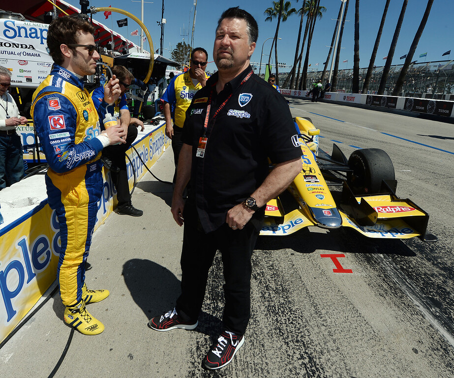 . Indycar driver Marco Andretti speaks to his father, and car owner, Michael Andretti Friday afternoon April 11, 2014 prior to the second practice session at the 40th Toyota Grand Prix of Long Beach. Simon Pagenaud, from France, led drivers with the quickest lap time of the day. Qualifying for Sunday\'s race is Saturday.  (Will Lester/Inland Valley Daily Bulletin)