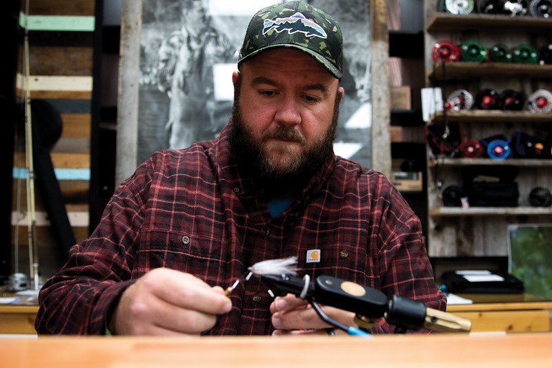 Matthew Gaston   The Sheridan Press<br>Chaz Davis ties the final knot completing this hand made fly, a Streamer Bait Fish Imitation Saturday, Oct. 6, 2018.