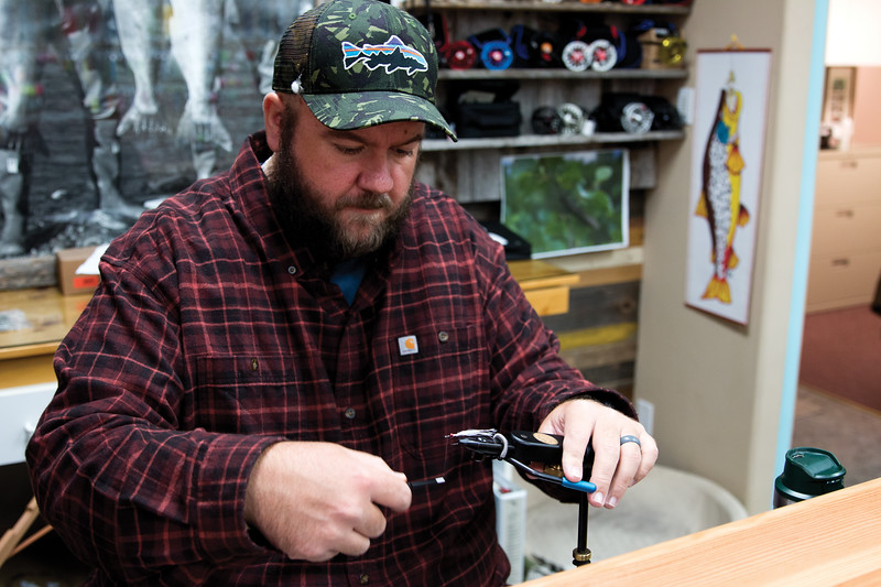 Matthew Gaston | The Sheridan Press<br>Chaz Davis, manager of the Fly Shop of the Bighorns, starts the first step in tying a fly Saturday, Oct. 6, 2018.