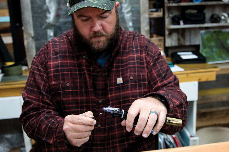 Matthew Gaston   The Sheridan Press<br>During stage two of tying a fly, Chaz Davis, adds some color to make this streamer more appealing to fish Saturday, Oct. 6, 2018.