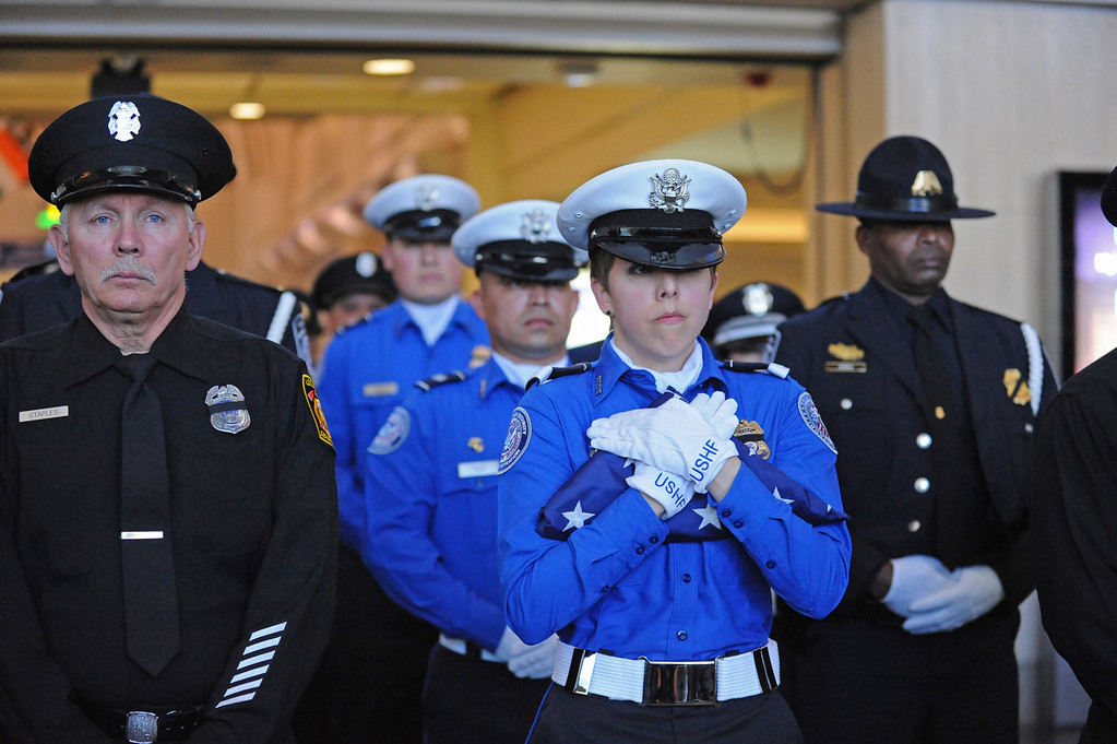 . TSA honor guard Brandy Richards carries the U.S. Honor Flag after it arrives at Los Angeles International Airport in memory of TSA agent Gerardo Hernandez. It will be used at his upcoming funeral services. (Wed, Nov 6, 2013. Photo by Brad Graverson/The Daily Breeze/POOL)