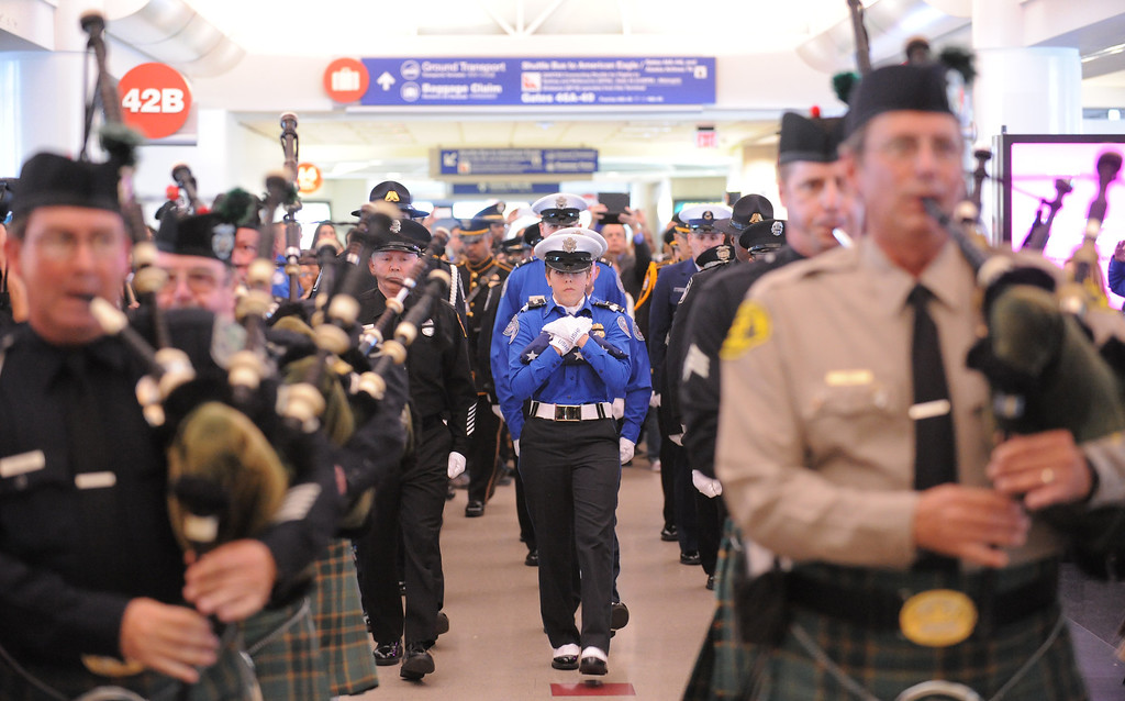 . TSA honor guard Brandy Richards carries the U.S. Honor Flag through Terminal 4 as it arrives at Los Angeles International Airport in memory of TSA agent Gerardo Hernandez. It will be used at his upcoming funeral services. (Wed, Nov 6, 2013. Photo by Brad Graverson/The Daily Breeze/POOL)