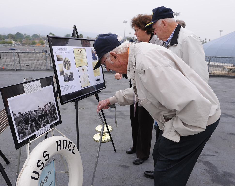 . Hoel survivor Larry Morris, 89, looks over a photo of the crew of the USS Hoel which was sunk this date 1944. Memorial aboard the USS Iowa, San Pedro.  (Fri. Oct. 25, 2013 Photo by Brad Graverson/The Daily Breeze)